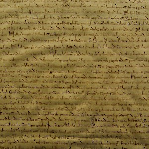 A detail from one of the two copies of the Magna Carta (1216) at the British Library of London (Photo © Reid Bramblett)