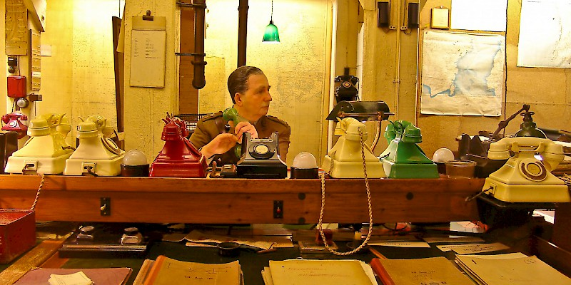 A mannequin mans the bank of phones in the Cabinet War Rooms, Churchill War Rooms, London (Photo © by Reid Bramblett)