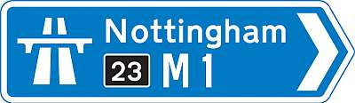 A motorway sign (the yellow-on-black number is the junction/exit number)