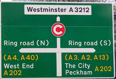 A sign at the Ring Road around London; your choices are left (north toward the West End), right (south toward The City) or straight ahead (into the Congestion Charge Zone and toward Westminster on local roads)