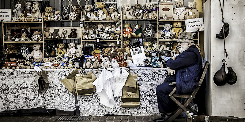 Market stalls—like this one, selling English Bears on Portobello Road in London—offer great authenticity and value (Photo by Claudio Accheri)