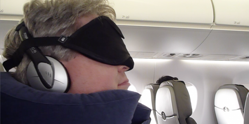The author wearing his sleeping-on-the-plane gear (Photo © Reid Bramblett)